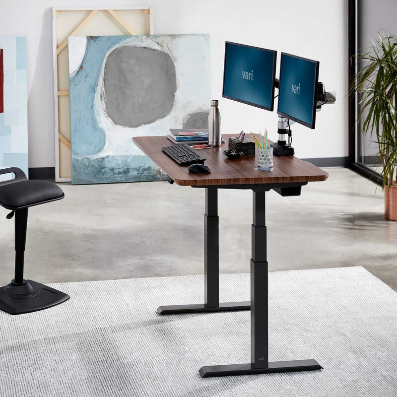 Electric Standing Desk 48x30 Darkwood in raised position at office image number null